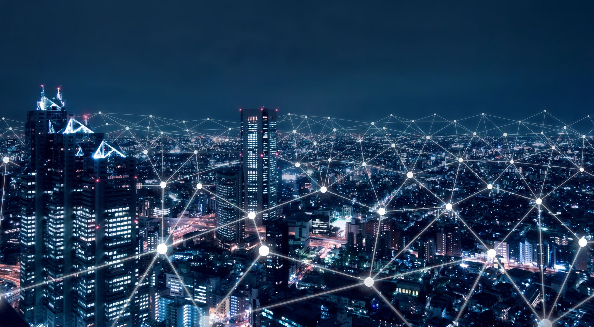 city lights at night overlaid with network points