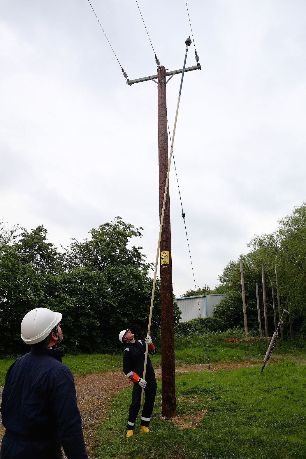 Engineer adding a smart navigator to overhead electricity power lines