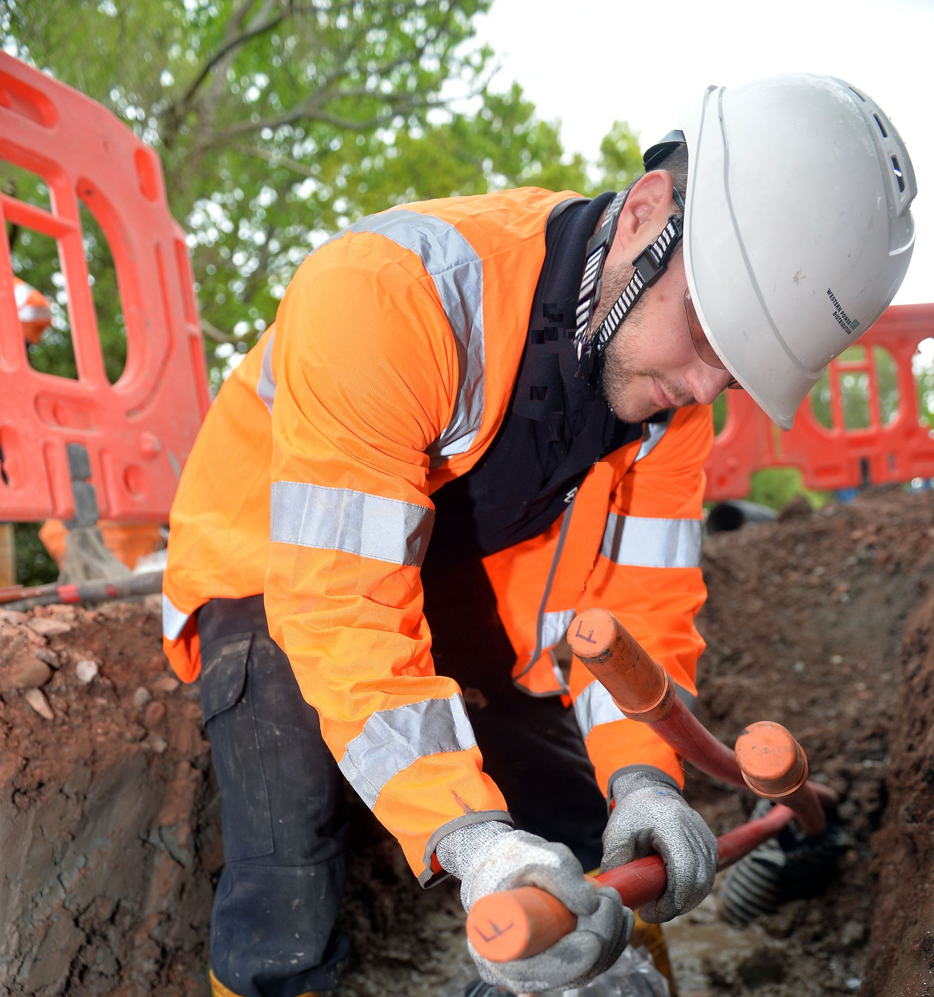 Western Power technician working on underground cables